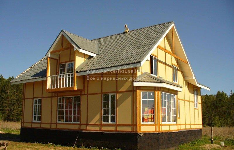Каркасный дом крытый металлочерепицей